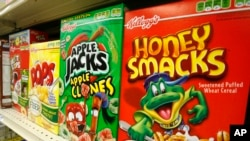 FILE - Boxes of Kellogg's Froot Loops, Corn Pops, Apple Jacks, and Honey Smacks sit on the shelf of a grocery store, June 25, 2010. Honey Smacks have been recalled over salmonella risk.