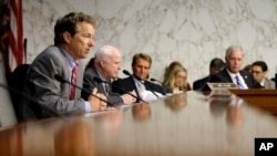 Senate Foreign Relations Committee members, from left, Sen. Rand Paul, Sen. John McCain, Sen. Jeff Flake, and Sen. Ron Johnson listen on Capitol Hill, Sept. 4, 2013, during the committee's hearing to consider the authorization for use of military force in Syria.