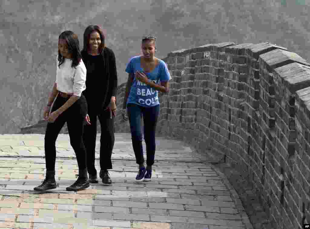 U.S. first lady Michelle Obama walks with her daughters Malia and Sasha as they visit the Mutianyu section of the Great Wall of China, March 23, 2014.