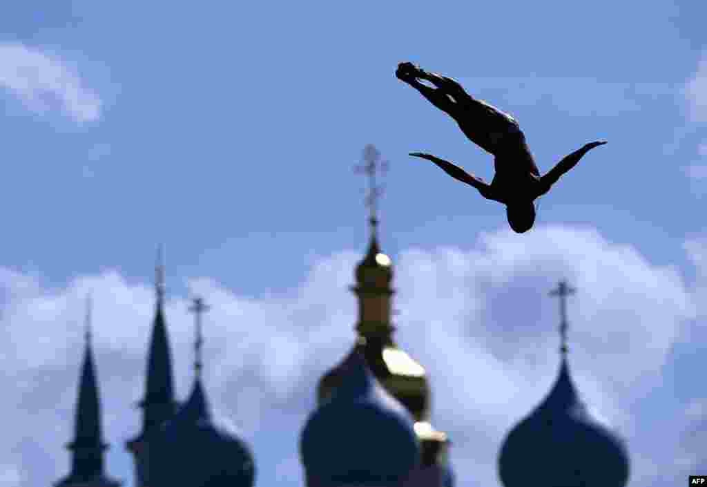 An athlete competes in the men's High Diving 27m preliminary round on day ten of the 16th FINA World Championships at the Kazanka River in Kazan, Russia.