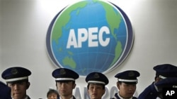 Japanese security officers stand guard at the APEC venue in Yokohama, near Tokyo, 10 Nov 2010