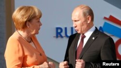 Канцлер Меркель і президент Путін