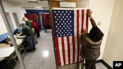 Election workers set up voting booths at Memorial Elementary School in Little Ferry, New Jersey, Nov. 6, 2012.