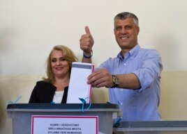 Kosovo's prime minister, Hashim Thaci, joined by his wife, Lumnije, casts his ballot at a polling station in the Kosovo capital of Pristina, June 8, 2014. K