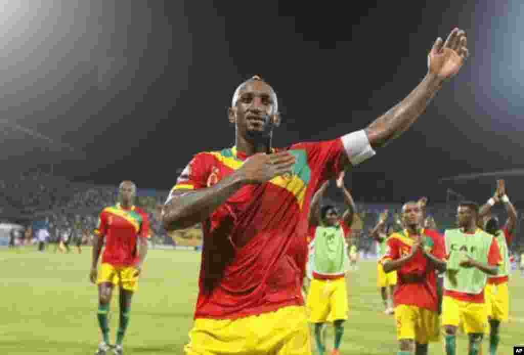 Guinea's Kamil Zayatte (front) celebrates after winning their African Nations Cup Group D soccer match against Botswana at Franceville Stadium January 28, 2012. Guinea won 6-1.