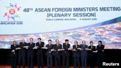 ASEAN foreign ministers pose for group photo in Kuala Lumpur, Malaysia, Aug. 4, 2015.
