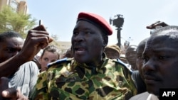 Lieutenant-Colonel Yacouba Issaac Zida (C) leaves the Place de la Nation square on October 31, 2014 in Ouagadougou after the resignation of Burkina Faso's President Blaise Compaore.