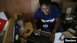 FILE - A staff member inputs data into a computer at a warehouse of Konga online shopping company in Ilupeju district in Nigeria's commercial capital Lagos Sept. 13, 2013.