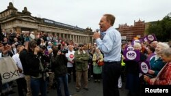 "Labour party MP Jim Murphy addresses a crowd during his ""100 streets in 100 days"" tour to promote the case for Scotland to remain part of the United Kingdom, in Edinburgh, Scotland, Sept. 2, 2014."