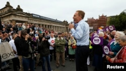 """Labour party MP Jim Murphy addresses a crowd during his """"100 streets in 100 days"""" tour to promote the case for Scotland to remain part of the United Kingdom, in Edinburgh, Scotland, Sept. 2, 2014."""