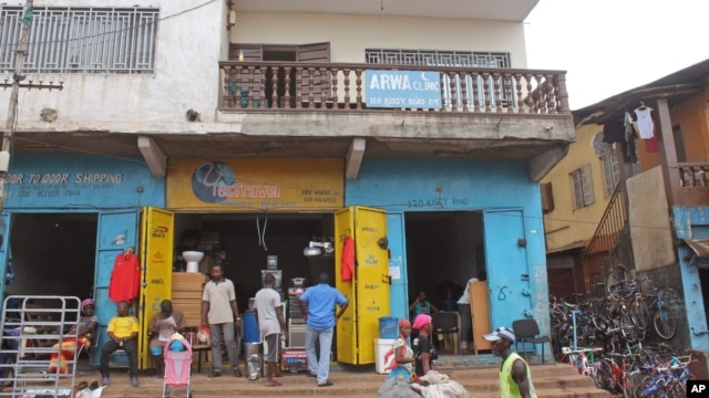 The Arwa clinic, center,  that was closed after the clinic Doctor got infected by the Ebola virus in the capital city of Freetown, Sierra Leone, July 15, 2014.