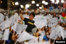 A supporter of Democratic Progressive Party (DPP) Chairperson and presidential candidate Tsai Ing-wen celebrates to preliminary results at their party headquarters in Taipei, Taiwan, Jan. 16, 2016.