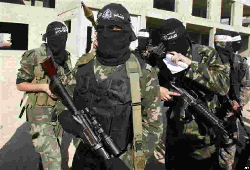 Masked Palestinian militants of the Hamas-allied Popular Resistance Committees, prepare to hold a press conference marking the 2nd anniversary of the Israel-Gaza war, in Gaza City, Monday, Dec. 27, 2010. Israel's volatile front with Gaza has been relative