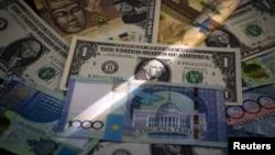 Kazakhstan's tenge and U.S. dollar banknotes are seen together in Almaty, Kazakhstan, Aug. 21, 2015.