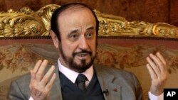 FILE - Rifaat Assad, an exiled uncle of Syrian President Bashar Assad, speaks during an interview in Paris, France, Nov. 15, 2011.