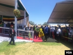 Emmerson Mnangagwa and his wife arriving at White City Stadium, Bulawayo.