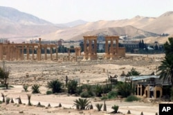FILE - This file photo released May 17, 2015, by the Syrian official news agency SANA, shows the general view of the ancient Roman city of Palmyra, northeast of Damascus, Syria.