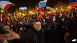 Pro-Russian people celebrate in the central square in Sevastopol, Ukraine.