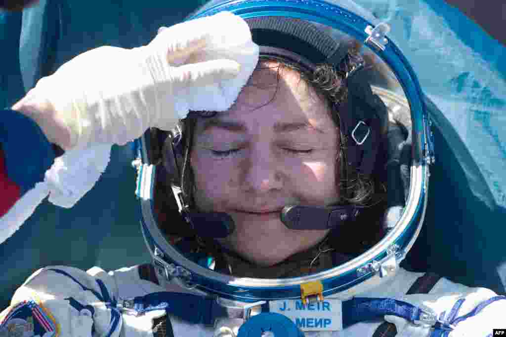 NASA astronaut Jessica Meir rests after landing in a remote area outside of Dzhezkazgan, Kazakhstan. Two NASA astronauts and a Russian cosmonaut returned from the International Space Station to find the planet transformed by the coronavirus pandemic.