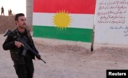 A Kurdish peshmerga fighter is seen in the southwest of Kirkuk, Iraq, Oct. 13, 2017.