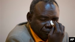 Clement Abaifouta, president of the association of victims of former Chadian dictator Hissène Habré , wipes away tears while listening to fellow victims recount their stories, at a press conference in Dakar, Senegal, Wednesday, July 17, 2013. Abaifouta, arrested in 1985, said he was forced for four years to dig graves for hundreds of prisoners. A lawyer said more than 1,000 victims of Habré have formally asked to participate in his trial on charges of war crimes, crimes against humanity and torture. (AP Photo/Rebecca Blackwell)