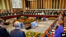 Leaders stand for a minute of silence for the victims of a deadly attack in the French city of Nice, before the opening session of the Asia-Europe Meeting (ASEM) summit in Ulaanbaatar, Mongolia, Friday, July 15, 2016.