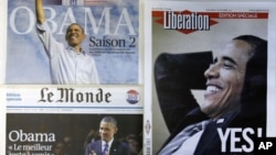 The front pages of special editions of French daily newspapers Le Figaro, Le Monde and Liberation published in Paris, Wednesday Nov. 7, 2012, following the re-election of U.S. President Barack Obama.