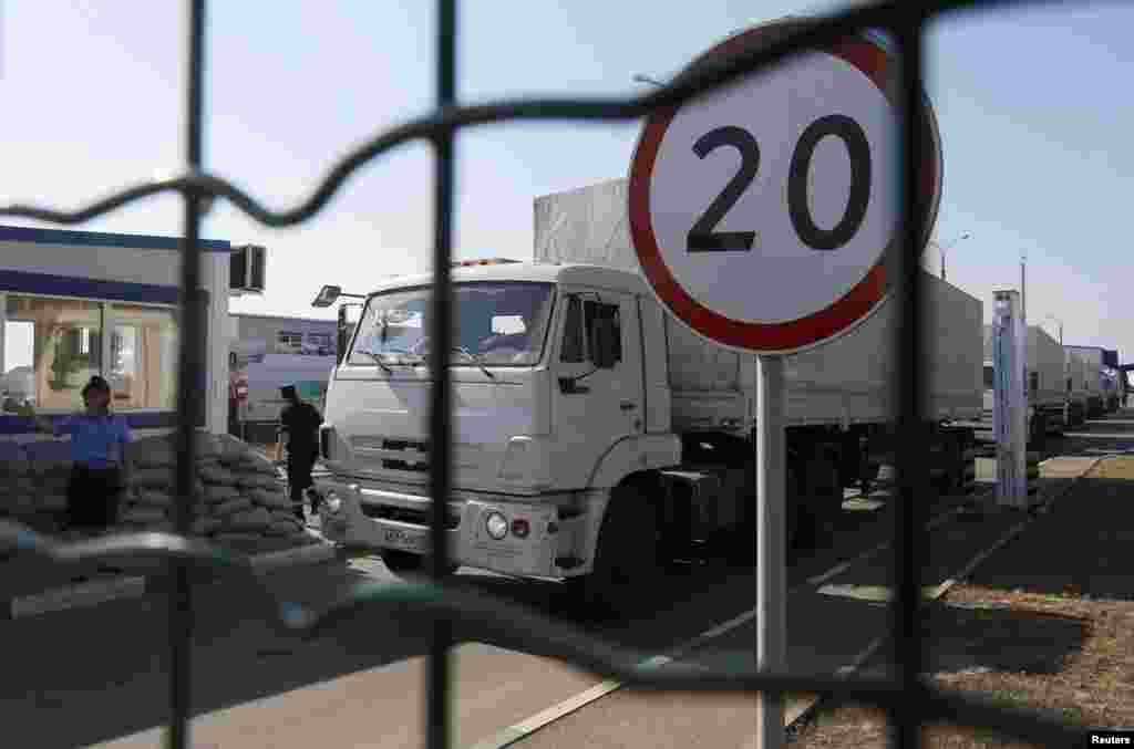 "Trucks from a convoy that delivered humanitarian aid for Ukraine move back to Russia at border crossing point ""Donetsk"" in Russia's Rostov Region, Aug. 23, 2014."