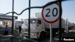 Trucks from a convoy that delivered humanitarian aid for Ukraine move back to Russia, Aug. 23, 2014.