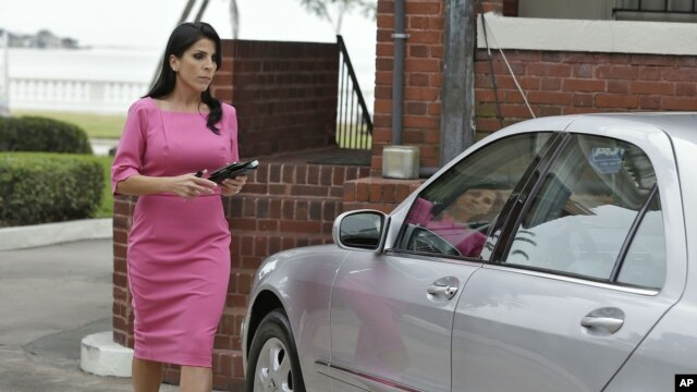 Jill Kelley leaves her home November 13, 2012 in Tampa, Fla.