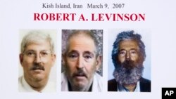 FILE- An FBI poster showing a composite image of former FBI agent Robert Levinson (right) of how he would look like now after five years in captivity, and an image (center) taken from the video, released by his kidnappers, and a picture before he was kidnapped displayed during a news conference in Washington. It's been 10 years since former FBI agent Robert Levinson disappeared while in Iran.
