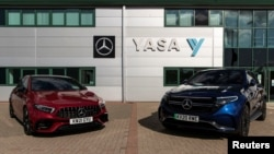 Two electric cars are parked at YASA headquarters and production facility in Oxford, Britain, August 24, 2021. Picture taken August 24, 2021. REUTERS/May James