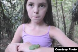 "Avalon Theisen, 14, organized Tampa, Florida's ""Save the Frogs Day"" event."