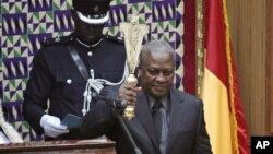 Ghana Vice President John Mahama is sworn in as new President of Ghana in parliament after the passing of the late Ghana President John Atta Mills in Accra, July 24, 2012.