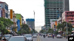 This July 2010 photo shows construction of high-rise buildings along Preah Monivong Boulevard, Phnom Penh's main thoroughfare.