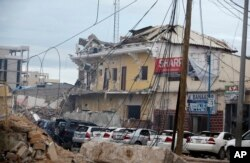 A view of Hotel Naso-Hablod, destroyed after a bomb attack in Mogadishu, Somalia, June 25, 2016. A Somali police officer says a suicide car bomber detonated an explosives-laden vehicle at the gate of a hotel in Mogadishu followed by gunmen who were fighti