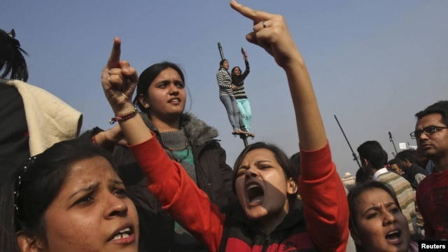 Demonstrators shout slogans near the presidential palace during a protest in New Delhi, Dec. 22, 2012.