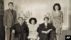 """Armenian """"Titanic"""" survivor Neshan Krekorian (seated left) with his wife, Persape (seated right), daughter Angie (center), son George (left), and daughter Alice (right)."""