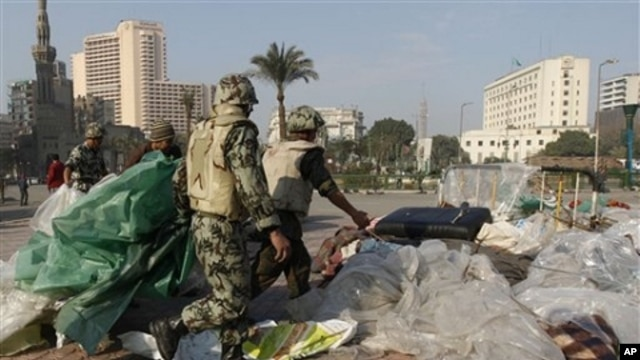 Egyptian Army soldiers remove tents of protesters from Tahrir Square in Cairo, Egypt, Sunday, Feb. 13, 2011. Egypt's military has started taking down the makeshift tents of protesters who camped out on Tahrir Square in an effort to allow traffic and norma