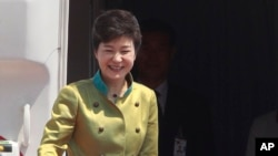 South Korean President Park Geun-hye greets well-wishers as she leaves for the United States, at the Seoul Military Airport in Seongnam, May 5, 2013.
