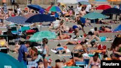 Sunbathers crowd the Ostia beach west of Rome on June 8, 2014.