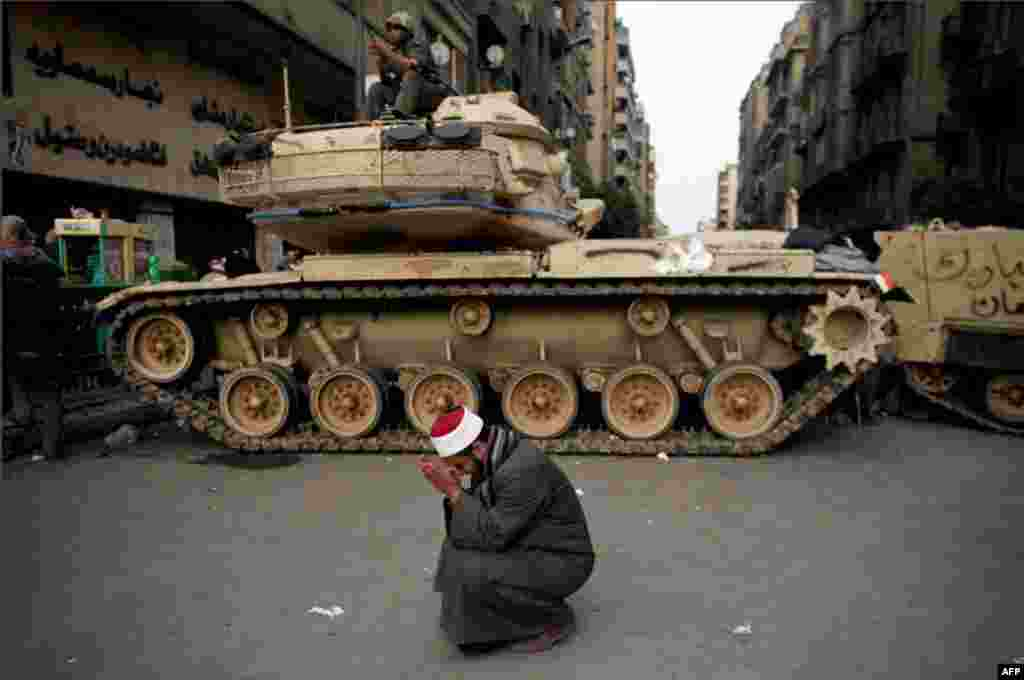 February 2: An egyptian cries in front of an army tank in Tahrir Square. (Tara Todras-Whitehill/AP)