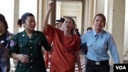 FILE - Nget Khun is taken to a court hearing.
