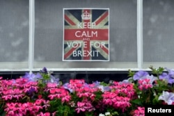 A vote 'Leave' poster is seen in a window in Chelsea, London, June 23, 2016.