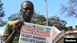 FILE - A news vendor displays newspapers in the Ugandan capital Kampala, Oct. 6, 2014. The World Health Organization is currently part of an effort working to rapidly contain an outbreak of the deadly Marburg virus disease in eastern Uganda on the border with Kenya, Oct. 20, 2017.