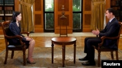 Syria's President Bashar al-Assad speaks during an interview with China's state television CCTV, in Damascus, Sept. 23, 2013.