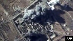 A video grab made on October 12, 2015, shows an image taken from a footage made available on the Russian Defense Ministry's official website, purporting to show explosions after airstrikes carried out by Russian air force on what Russia says was an Islamic State training camp in the Syrian province of Idlib.