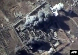 FILE - A video grab from Oct. 12, 2015, to show explosions after airstrikes carried out by Russian air force on what Russia says was an Islamic State ammunition depot in the Syrian province of Idlib.