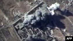 Image fixée d'une vidéo montrant des explosions après des frappes aériennes menées par la force aérienne russe sur un camp d'entraînement de l'État islamique dans la province syrienne d'Idlib. Séquence d'image disponible sur le site officiel du ministère russe de la Défense, 12 octobre 2015