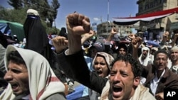 Anti-government protesters shout slogans during a demonstration demanding the resignation of Yemeni President Ali Abdullah Saleh, in Sana'a, March 11, 2011